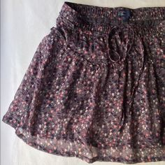 AEO Flouncy Miniskirt Flirty floral miniskirt from American Eagle. Pair with tights and boots for a perfect fall look! American Eagle Outfitters Skirts Mini