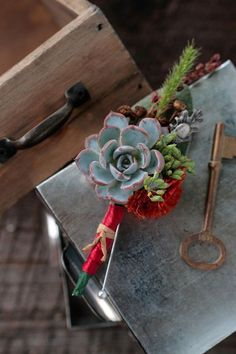 rustic and textural boutonniere with succulents