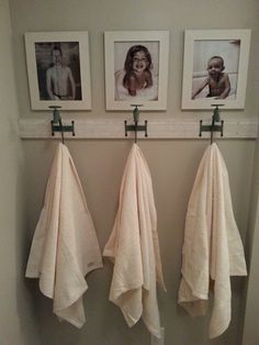 Bathroom hooks and picture wall for the kids. I wanna do this for my dog's leashes!! hehe