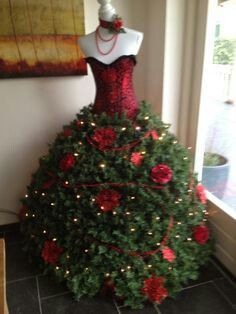Christmas decorative dress form / mannequin with deep red corset & large red roses