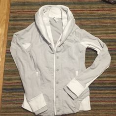 Lululemon to class jacket size 8 white wee stripe Size 8 Lululemon with rip tag still attached as shown.  Worn only a few times.  There is a stain at one of the cuffs as shown.  Rare colors that are hard to find! lululemon athletica Tops Sweatshirts & Hoodies