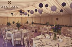 Lavender coloured wedding with hanging paper lanterns