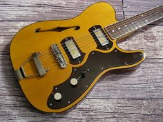 The TimeFlite Archer is a grand tribute to the vintage instruments that powered everything from Chicago blues to the garage band explosion. Guitar Rig, Acoustic Guitar, Gold Foil Pickups, Telecaster Thinline, Types Of Guitar, Thing 1, Beautiful Guitars, Guitar Design, Electric Guitars