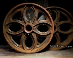 For your industrial coffee table, here's a dope pair of huge antique Lineberry cart wheels from Iron Anarchy.