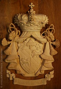 A coat of arms for the Italian family 'Bonelli di Salci'. | High relief carving in limewood | Familiy crest carved in wood | Heraldic Woodcarving