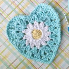This free heart crochet pattern is a beautiful pattern with a daisy in the center and a granny pattern around the edges. It's perfect for Valentine's Day!
