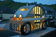 This car-shaped eco home in Austria has energy efficient heating and cooling.