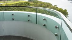 Curved toughened glass with Stainless Handrail. Glass Pool Fencing, Pool Fence, Glass Balustrade, Curved Glass, Splashback, Brisbane, Facade, Concrete, Australia