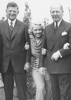 Joan Blondell on the Warner Bros. lot with Mayor Edward Kelly of Chicago and Mayor Frank Hague of Jersey City, 1935.