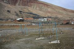 Rusting Swings. Pyramiden, Norway was a Russian settlement and coal mining community. Sold from Sweden to the Soviet Union in 1927, the area was closed and abandoned in 1998 and is now only accessible by boat or snowmobile.