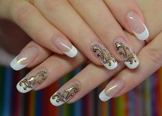 It is an excellent example of french manicure, made of clear varnish with small sparkling pieces. A special highlight of this manicure the golden figure gives, which underlined with a black outline. Such a design of nails is convenient for a cocktail party. And playful monograms only add mystery to …