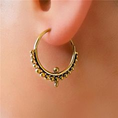 Brass Earring - Brass Hoops - Brass Tribal Earring - Hoops Jewelry - Brass Jewelry - Tribal Jewelry - Ethnic Jewelry (Code: EB82)  One of our new hits . A septum ring look but in a big diameter to wear on your ear and could make a beautiful set with your septum ring.  Length: 23mm Width: 22mm Bar size: 1mm  Sold as pair. $14.5