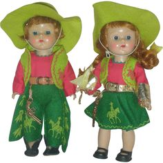 Here is a pair of vintage 1950s Vogue Ginny Cowgirl and Cowboy Dolls. Facial coloring is bright. Each Doll has a gold gun attached to belt. ..