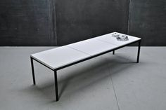 USA, c.1950s. Vintage Mid-Century Modern Florence Knoll T Angle Design. A Three Panel White Micarta Coffee Table, Black Iron T-Angle Framed Construction. Very Light Wear, Very Good Condition.    W: 72 x D: 20 x H: 15.75 in.