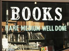 I want this sign/saying somewhere in my house...probably in my own personal library :)
