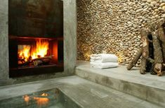 Creative bathroom design - bathing in front of an open fire.