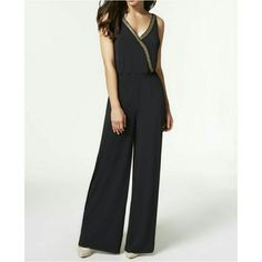 Black Embellished Jumpsuit Wrap front V-neck jumpsuit with gold embellishment.  Perfect for date night or a night out with the girls. NWT. 95% polyester 5% elastane.  Machine washable.  If you have questions,  I'm always happy to help!   Happy Poshing! Dresses