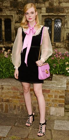 Look of the Day - Elle Fanning from InStyle.com//Elle Fanning assumed the Gucci girl character for the luxury brand's Cruise 2017 show, in which she wore a black velvet number with a lace-trimmed neckline and sheer organza sleeves, styled with a sweet bubblegum pink scarf that matched her quilted double-G purse, and T-strap sandals—all by Gucci, of course.