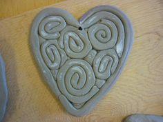 Mrs. Jahner's Art Room: Kindergarten Clay Hearts http://ourartroomrocks.blogspot.com/2010/02/kindergarten-clay-hearts.html