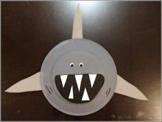 We& across a nice paper plate shark craft by Cindy and her son Trevor from My Creative Life. Cindy uses paper plates, coloured card stocks and googly eyes but we don& have card stock and& Daycare Crafts, Classroom Crafts, Toddler Crafts, Kids Crafts, Preschool Beach Crafts, Beach Crafts For Kids, Paper Plate Art, Paper Plate Crafts, Paper Plates