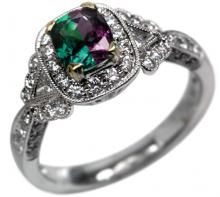 alexandrite ring. Such a lovely stone as it looks kelly green in sunlight and deep purple/blue in indoor light,