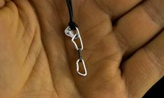 Miniature climbing jewelry. Quickdraw. -----------------------Production Details--------------------- Sterling silver (925) Dimensions: size 15х 5mm ( 0,59 х 0,2 inch) weight 1 gram Each pendant comes with a black waxed cotton cord ready to be worn. Also, you can buy an exclusive gift bags