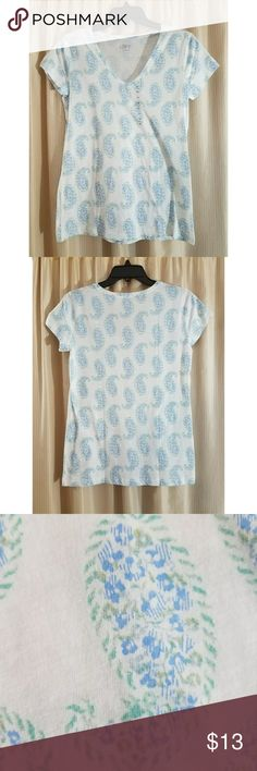 LOFT Paisley Print Tee NWOT paisley tee from LOFT. White short sleeve tees, with green/aqua/blue paisley design all over, vneck. Prefect with a pair, shorts, capris, or jeans in my closet! 100% cotton. Size S. Approx measurements: 17in bust; 25in length shoulder to hem. LOFT Tops Tees - Short Sleeve