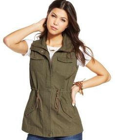A cargo vest is stylishly urban with utilitarian flap pockets and a safari-chic drawstring waist. From American Rag. | Cotton | Machine washable | Made in China | Juniors' vest | High collar  | Front