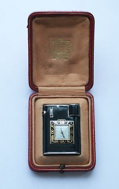 Cartier - Black enamel Sterling silver watch lighter -