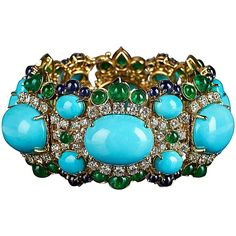 Veschetti Emerald sapphire turquoise diamond bracelet | From a unique collection of vintage link bracelets at https://www.1stdibs.com/jewelry/bracelets/link-bracelets/
