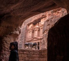 Photo by (Muhammed Muheisen) Looking at Al-Khazneh, Arabic for the Treasury, through a tomb, one of many facades carved into the… National Geographic Travel, Climate Change Effects, Face Light, Vancouver Island, Week End, More Photos, Beautiful World, Bald Eagle, Travel Photography