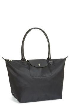 Longchamp All-Black Bag, $180 LINK: http://shop.nordstrom.com/s/longchamp-le-pliage-neo-large-tote/3767054?
