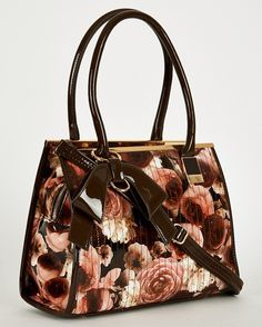 £30. Patent Floral Print Brown Handbag  Key Features: - Glossy Patent Partly Rigid Bag - Floral Print All Over - Top Zip Fastening, Decorative Bow And Stitch Details - Grab Handle, Detachable And Adjustable Shoulder Strap Material: - Patent Faux Leather - Synthetic Material Approx. Measurements: - Width 31cm - Height 24 cm - Depth 12cm. #eyebrows #beautiful #fashion #beauty #foundation #nails #makeup #hair #mac #goals #want #facebook #outfitoftheday #chanel #pink #uk #lipstick #kyliejenner…