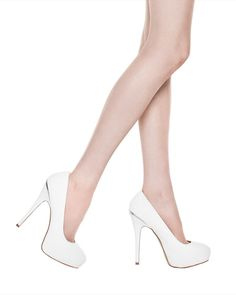 If you want to buy white heels, simple white pumps like these are ideal.