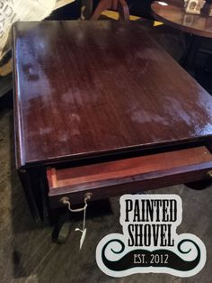 Antique drop leaf table sold by auction at Painted Shovel in Avondale, AL.