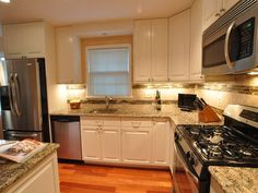 Giallo Fiorito Granite Countertop White Cabinets