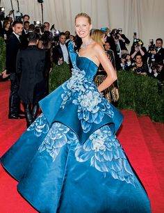 Karolina Kurkova in a Marchesa sculpted satin-organza dress with hand-painted floral illustrations. Get a sneak peek at the Met Gala Special Edition on Vogue.com.