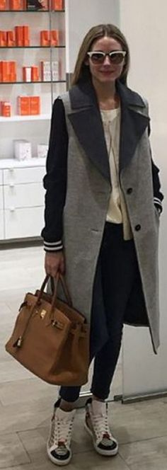 Who made Olivia Palermo's stripe sneakers, gray vest, sunglasses, and brown tote handbag?
