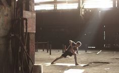 love the contrast of the warehouse and the yoga and the sunlight.