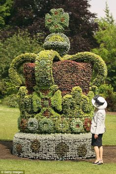A woman admires a large floral crown in St James's Park, made to celebrate the Diamond Jubilee