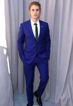 Justin Bieber serves prom style straight up with a twist on the classic suit. Go for a sleek solid color, and finish it off with a skinny tie.