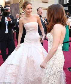 Injured Kristen Stewart gets comforted by Jennifer Lawrence as she hobbled along the #Oscars2013 red carpet on crutches.