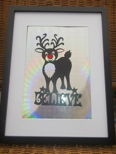 Original, hand drawn 'Rudolph - Believe' papercut with a red glittery nose. By NIna Byers. Available to order from my Facebook page.