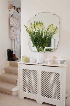 Use these radiator cover ideas to transform your room. See how to use a radiator cover for storage, reading nooks under windows, corner cabinets + more. Shabby Home, Estilo Shabby Chic, Stair Landing, Radiator Cover, Radiator Screen, Radiator Shelf, Small Hallways, Flat Ideas, Decoration Design