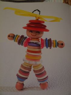 Dolls Made with Buttons | Source: Diane Fitzgerald's Favorite Beading Projects )