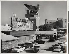 """Googie style front entrance and porte-cochère of the Thunderbird Hotel in Las Vegas, circa 1950s. Part of the UNLV Libraries """"Dreaming the Skyline: Resort Architecture and the New Urban Space"""" digital collection."""
