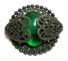 """LOVELY VINTAGE 40'S ERA LACY FILIGREE METAL CAPE BUTTON w/EMERALD GREEN JEWEL.  Not old enough to be a Gay 90's, but was """"in the style of."""""""