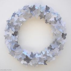 Stashbusting butterfly wreath made from security envelopes and a pool noodle -- Amazing.  Window display idea:  a large one with butterflies flying from it.