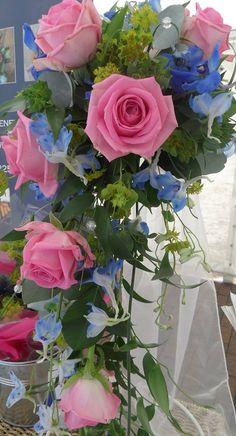 aqua rose and blue delphinium teardrop bouquet