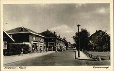 Beeldbank Prentbriefkaarten - De Kometensingel heeft lage huizen met buurtwinkels.